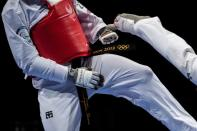 Kicks to the head are strictly forbidden in the Paralympic version of the sport (AFP/Philip FONG)