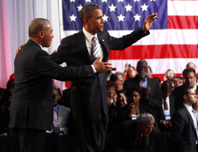 Massachusetts Gov. Deval Patrick introduces President Barack Obama at a Democratic National Committee campaign fundraising event at the Boston Center for the Arts in Boston, Wednesday, May 18, 2011. (AP Photo/Charles Dharapak)