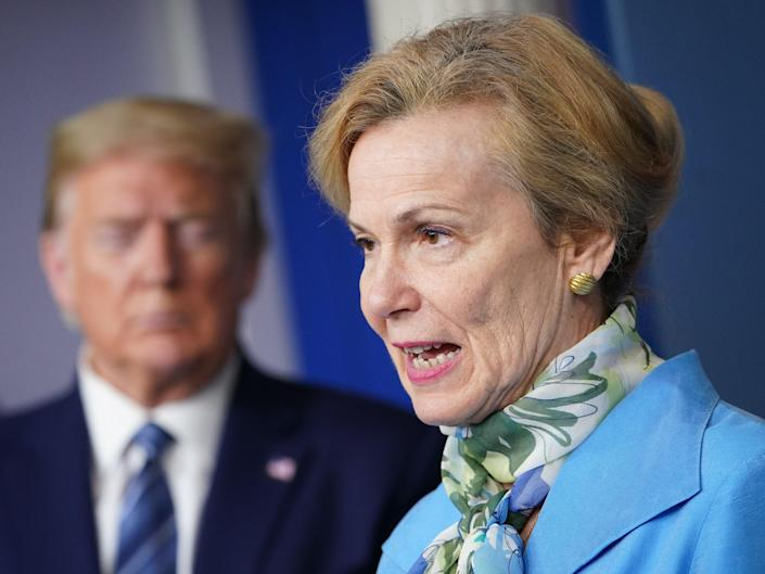 Deborah Birx speaks as Donald Trump listens during a briefing on COVID-19 on April 21, 2020 (AFP via Getty Images)
