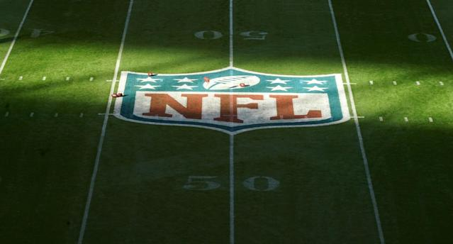 "Oct 27, 2019; London, United Kingdom; Detailed view of the NFL Sheild logo at midfield during an NFL International Series game between the <a class=""link rapid-noclick-resp"" href=""/nfl/teams/la-rams/"" data-ylk=""slk:Los Angeles Rams"">Los Angeles Rams</a> and the <a class=""link rapid-noclick-resp"" href=""/nfl/teams/cincinnati/"" data-ylk=""slk:Cincinnati Bengals"">Cincinnati Bengals</a> at Wembley Stadium. Mandatory Credit: Kirby Lee-USA TODAY Sports"