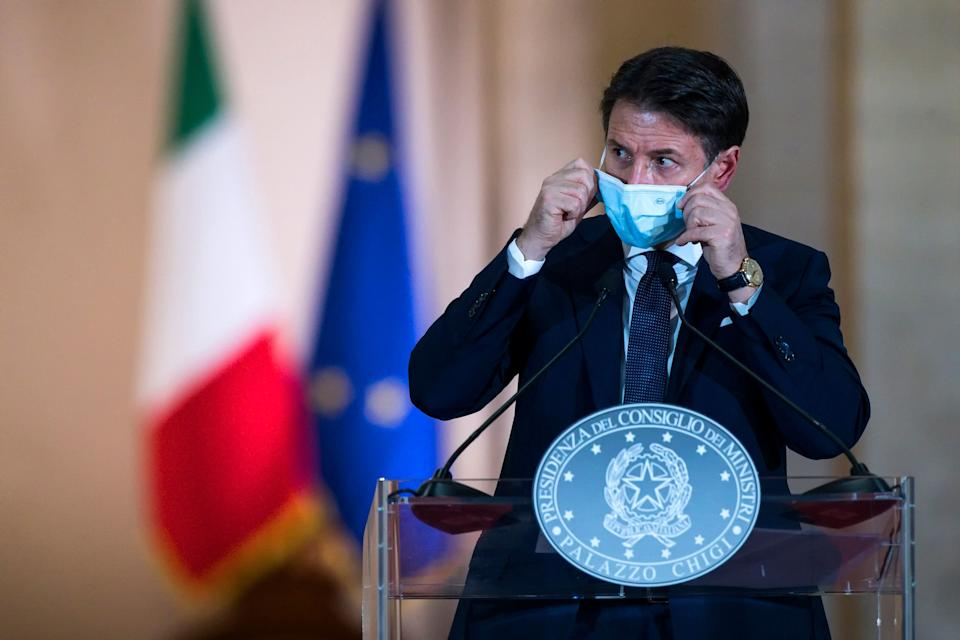 This photo taken on October 18, 2020, and provided by Italian news agency ANSA shows Italian Prime Minister Giuseppe Conte giving a press conference to present new measures to tackle the spread of the Covid-19 disease caused by the coronavirus, at Rome's Palazzo Chigi. - Conte announced on October 18, 2020, new restrictions on bars and restaurants and pushed to increase working from home. (Photo by ANGELO CARCONI / various sources / AFP) / Italy OUT (Photo by ANGELO CARCONI/POOL/AFP via Getty Images) (Photo: ANGELO CARCONI via Getty Images)