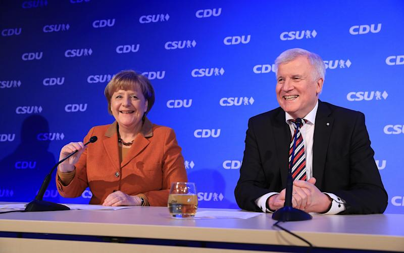 Angela Merkel, Germany's chancellor and leader of the Christian Democratic Union (CDU) party, left, and Horst Seehofer, Bavarian premier and leader of the Christian Social Union (CSU) party - © 2017 Bloomberg Finance LP