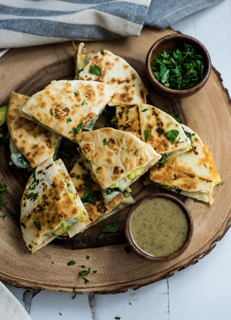 "<p>You can make this delicious finger food with frozen shrimp and spinach to make your Super Bowl preparations a little bit easier.</p><p><strong>Get the recipe at <a href=""http://cookingandbeer.com/2017/02/mini-spinach-and-shrimp-quesadillas-with-avocado/"" rel=""nofollow noopener"" target=""_blank"" data-ylk=""slk:Cooking and Beer"" class=""link rapid-noclick-resp"">Cooking and Beer</a>.</strong></p><p><strong><a class=""link rapid-noclick-resp"" href=""https://www.amazon.com/Farberware-Performance-Nonstick-Aluminum-11-Inch/dp/B00FGUXFSI/?tag=syn-yahoo-20&ascsubtag=%5Bartid%7C10050.g.2966%5Bsrc%7Cyahoo-us"" rel=""nofollow noopener"" target=""_blank"" data-ylk=""slk:SHOP GRIDDLE PANS"">SHOP GRIDDLE PANS</a><br></strong></p>"