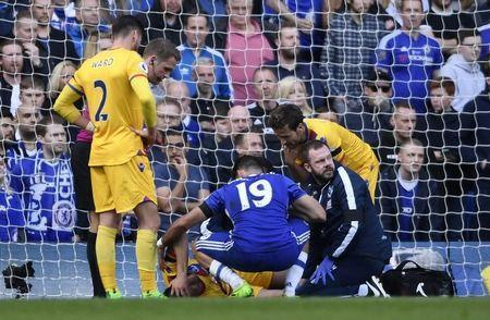 Britain Soccer Football - Chelsea v Crystal Palace - Premier League - Stamford Bridge - 1/4/17 Crystal Palace's Joel Ward receives treatment after sustaining an injury Action Images via Reuters / Tony O'Brien Livepic