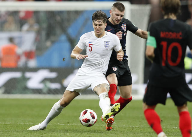 So close: John Stones challenges for the ball with Croatia's Ante Rebic
