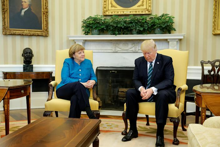 Trump and German Chancellor Angela Merkel wait for reporters to enter the room before their meeting in the Oval Office on March 17.