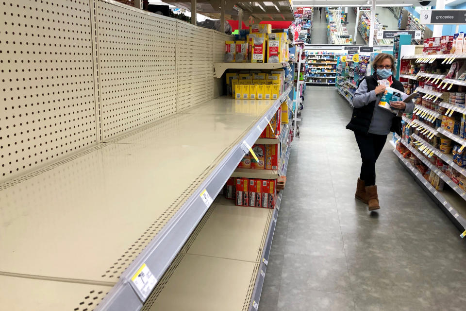 Shelves in the toilet paper aisle at a Walgreens store sit empty in Buffalo Grove, Ill., Wednesday, Nov. 18, 2020. A surge of new coronavirus cases in the U.S. is sending people back to stores to stockpile again, leaving shelves bare and forcing retailers to put limits on purchases. (AP Photo/Nam Y. Huh)