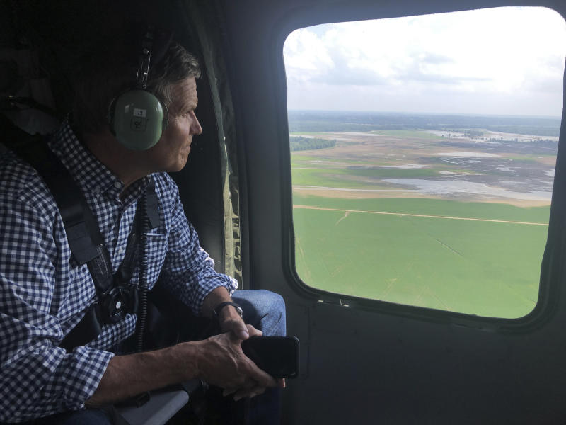Gov. Bill Lee looks out the window during an aerial tour over flooded crop land in Dyer County, Tenn., Wednesday, July 17, 2019. Lee took the aerial tour of flooded crop land in western Tennessee and promised support to farmers struggling with when to plant. (AP Photo/Kimberlee Kruesi)