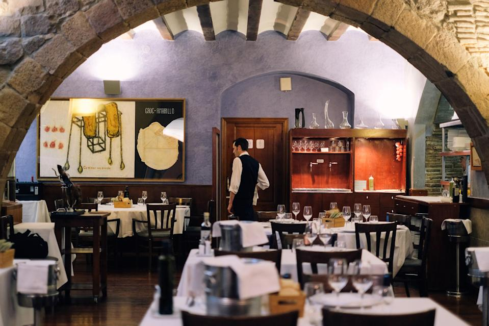 """<p><strong>Tell us about your first impressions when you arrived.</strong><br> Passadis del Pep is almost impossible to find, situated at the end of a shabby-looking corridor next to a bank on one of Barcelona's busy squares. Once you walk through the door, you will discover the vaulted dining room of one of Barcelona's most emblematic restaurants. Passadis del Pep has attracted more than its fair share of celebrities over the years, but the ambience remains the same as it always was—authentic, informal, and laid-back.</p> <p><strong>What was the crowd like?</strong><br> This place is not exactly easy to find, so few people walk in off the street. You can be fairly certain that most diners at Passadis del Pep are here on a specific mission to eat some of the best-quality food on offer in Barcelona. The atmosphere is cheerful and lively.</p> <p><strong>What should we be drinking?</strong><br> There are more than 200 different wines on Passadis del Pep's impressive list, but its real specialty is cava. All guests receive a complimentary glass of the sparkling stuff on arrival, as well as a sampling of liqueurs after their meal.</p> <p><strong>Main event: the food. Give us the lowdown—especially what not to miss.</strong><br> What is perhaps most notable about Passadis del Pep is that there is no menu to read. Invite your server to take a seat at the table and explain to him or her what you want to eat, what you don't want to eat, and what your budget is. What will follow is an expertly executed tasting menu using the finest seasonal produce carefully adapted to your tastes, budget, and dietary requirements. Prices range from around $70 per person to whatever you are willing to spend. All the food is made from ingredients sourced fresh from the market that same day (hence the daily changing menu). House specials including Iberian """"Joselito"""" ham with tomato bread, grilled baby squid, and chicken and foie gras cannelloni.</p> <p><strong>And how did you find the front of """