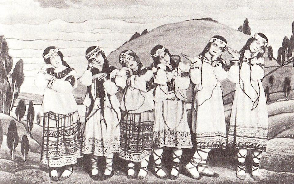 a black and white photograph of dancers