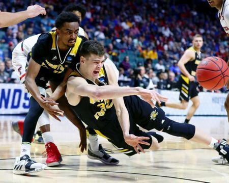 Mar 22, 2019; Tulsa, OK, USA; Northern Kentucky Norse center Chris Vogt (33) collides with guard Jalen Tate (left) while trying to control a loose ball against the Texas Tech Red Raiders during the second half in the first round of the 2019 NCAA Tournament at BOK Center. Mandatory Credit: Mark J. Rebilas-USA TODAY Sports