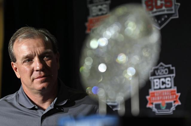 Florida State head coach Jimbo Fisher poses with The Coaches' Trophy during a news conference for the BCS National Championship NCAA college football game Tuesday, Jan. 7, 2014, in Newport Beach, Calif. Florida State beat Auburn 34-31 to win the championship the night before. (AP Photo/David J. Phillip)