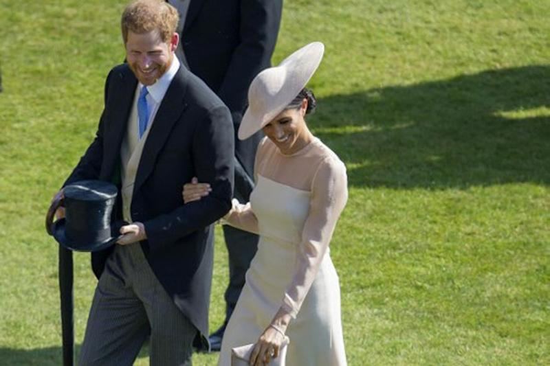 Newlyweds Harry and Meghan Markle Make First Appearance