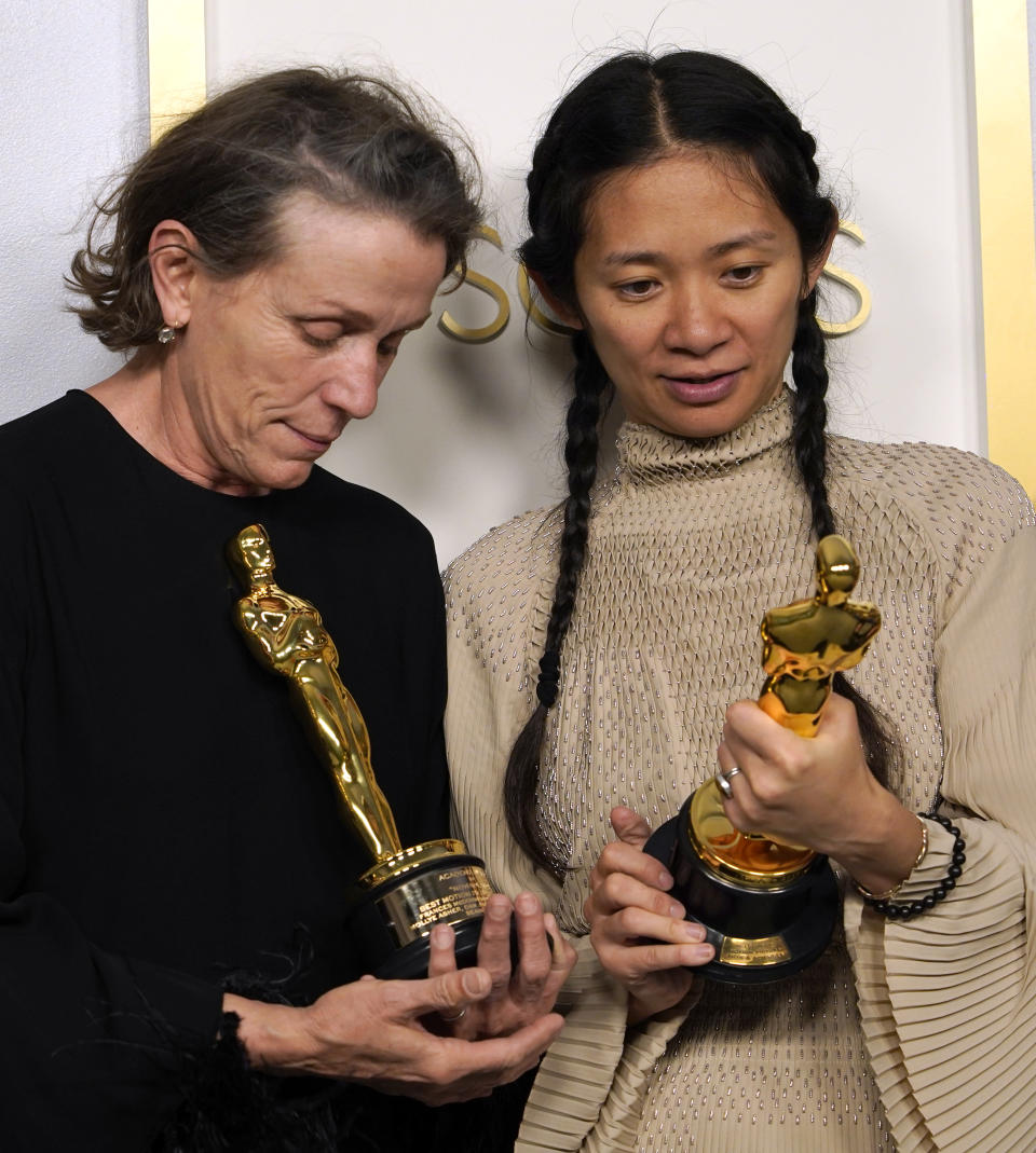 """Producers Frances McDormand, left, and Chloe Zhao, winners of the award for best picture for """"Nomadland,"""" pose in the press room at the Oscars on Sunday, April 25, 2021, at Union Station in Los Angeles. (AP Photo/Chris Pizzello, Pool)"""