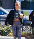 <p>Vanessa Hudgens grabs a coffee as she leaves the Dog Pound gym in L.A. on Oct. 13.</p>