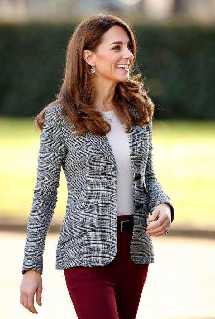 <p>The Duchess of Cambridge attended Shout's Crisis Volunteer celebration event at Troubadour White City Theatre on November 12, 2019 wearing an autumn-appropriate outfit: cranberry pants and a classic black and white tweed blazer. </p>