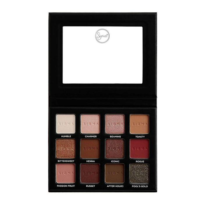 """<p><strong>Sigma Beauty</strong></p><p>amazon.com</p><p><strong>$39.00</strong></p><p><a href=""""https://www.amazon.com/Sigma-Beauty-Neutrals-Eyeshadow-Palette/dp/B077GZHHZZ?tag=syn-yahoo-20&ascsubtag=%5Bartid%7C2089.g.256%5Bsrc%7Cyahoo-us"""" rel=""""nofollow noopener"""" target=""""_blank"""" data-ylk=""""slk:Shop Now"""" class=""""link rapid-noclick-resp"""">Shop Now</a></p><p>Sigma Beauty's 12-shade eyeshadow palette features hues ranging from a matte-white color called Humble to a glittery green-black color named Fool's Gold. The packaging is compact and sleek, with a mirror on the top panel for creating looks on the go.</p>"""