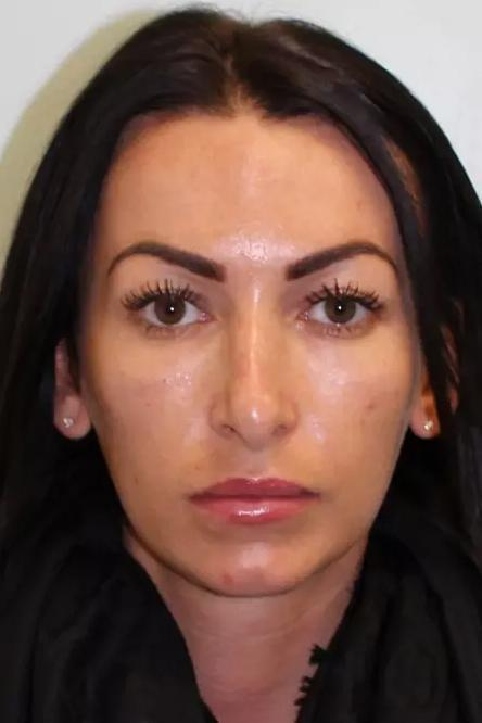 Fraud: The model in her police mugshot (Met Police)