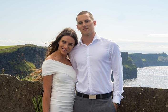Andela and Mateo Rako pose for wedding pictures taken by Kevin Hennessy on the Cliffs of Moher, Ireland.