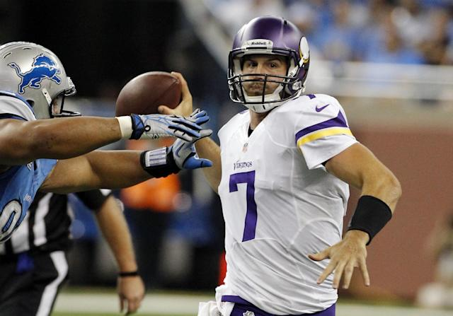 Minnesota Vikings quarterback Christian Ponder (7) is pressured by Detroit Lions defensive tackle Ndamukong Suh during the third quarter of an NFL football game at Ford Field in Detroit, Sunday, Sept. 8, 2013. (AP Photo/Duane Burleson)