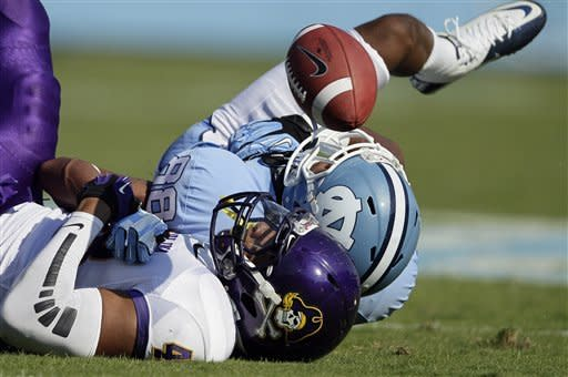 East Carolina's Maurice Falls, foreground, breaks up a pass intended for North Carolina's Erik Highsmith (88) during the first half of an NCAA college football game in Chapel Hill, N.C., Saturday, Sept. 22, 2012. (AP Photo/Gerry Broome)