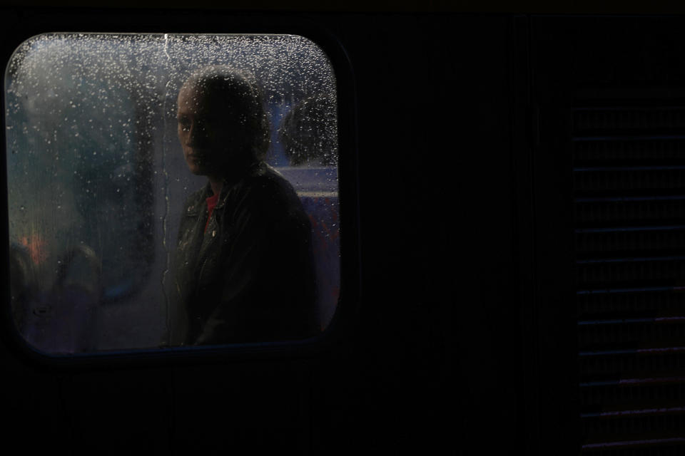 A commuter sits on a bus in the early morning rush hour as heavy rain falls in London, Friday, Oct. 1, 2021. (AP Photo/Alastair Grant)