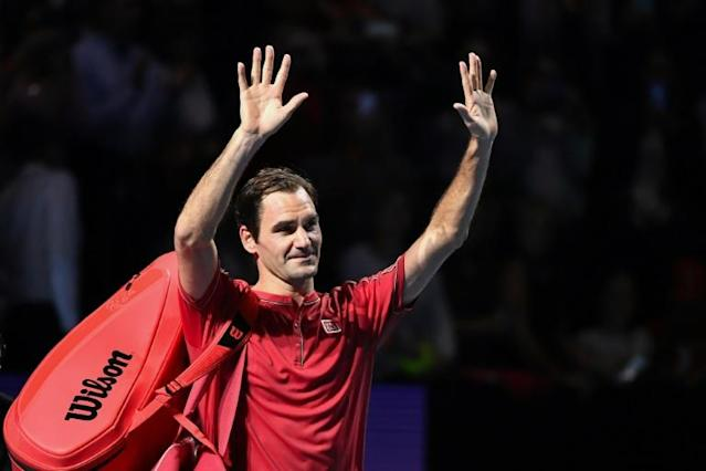 Federer acknowledges crowd in Basel after 1,500th career win (AFP Photo/FABRICE COFFRINI)