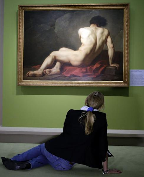 "A visitor looks at the painting ""Académie d'Homme"" by French artist Jacques-Louis David during the ""Masculin/Masculin"" exhibition at the Orsay Museum on September 23, 2013 in Paris"