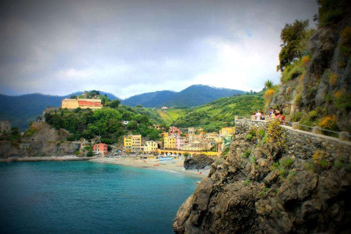 """<p>We weave up, up, up through olive groves and giant trees rooted long before our time. The air is clear, fragrant with fresh growth and bright green. I can see our destination in the distance: Monterosso.<br></p><p><i>(Photo: <a href=""""http://www.dtravelsround.com/"""" rel=""""nofollow noopener"""" target=""""_blank"""" data-ylk=""""slk:D Travels Round"""" class=""""link rapid-noclick-resp"""">D Travels Round</a>)</i><br></p>"""
