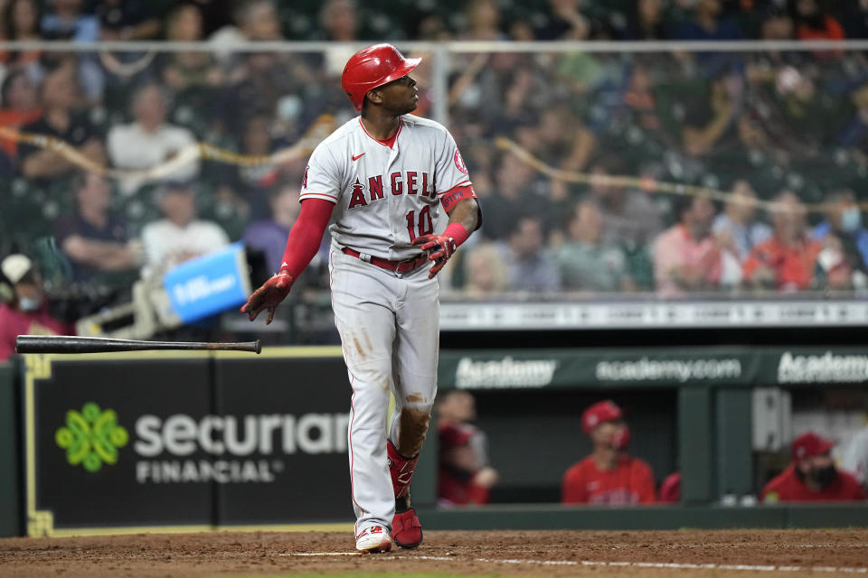 Los Angeles Angels' Justin Upton watches his home run against the Houston Astros during the sixth inning of a baseball game Monday, May 10, 2021, in Houston. (AP Photo/David J. Phillip)