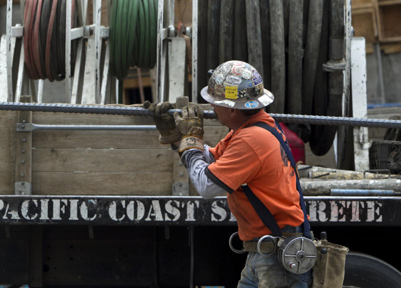 In this March 6, 2012 photo, an ironworker with Local Union 416, carries steel rods for a retaining wall at a construction site in Los Angeles. U.S. employers added 227,000 jobs in February to complete three of the best months of hiring since the recession began. The unemployment rate was unchanged, largely because more people streamed into the work force. The Labor Department said Friday, March 9, 2012, that the unemployment rate stayed at 8.3 percent last month, the lowest in three years. (AP Photo/Damian Dovarganes)