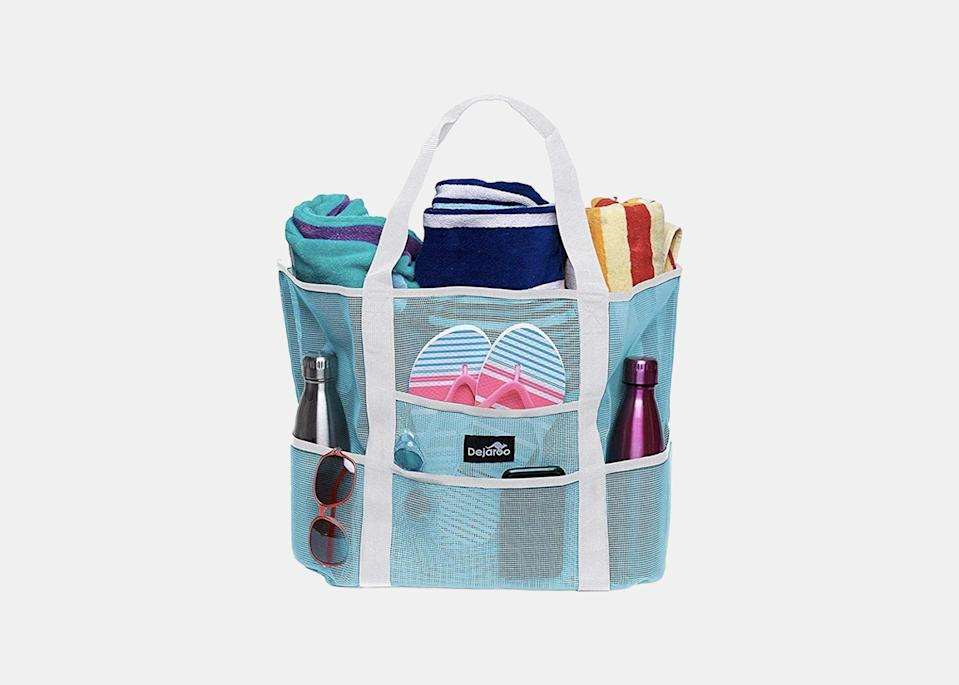 """Any parents can visualize the ubiquitous image of families toting multiple bags to the beach. Well, imagine no more, says Seligman, thanks to this mesh tote bag with eight pockets that can separate all your beach needs, from <a href=""""https://www.cntraveler.com/gallery/best-sunglasses-according-to-editors?mbid=synd_yahoo_rss"""" rel=""""nofollow noopener"""" target=""""_blank"""" data-ylk=""""slk:sunglasses"""" class=""""link rapid-noclick-resp"""">sunglasses</a> and <a href=""""https://www.cntraveler.com/gallery/best-beach-towels-of-the-summer?mbid=synd_yahoo_rss"""" rel=""""nofollow noopener"""" target=""""_blank"""" data-ylk=""""slk:towels"""" class=""""link rapid-noclick-resp"""">towels</a> to snacks (the ones that don't need to go in <a href=""""https://www.cntraveler.com/story/best-coolers?mbid=synd_yahoo_rss"""" rel=""""nofollow noopener"""" target=""""_blank"""" data-ylk=""""slk:the cooler"""" class=""""link rapid-noclick-resp"""">the cooler</a>), sunblock, kids toys, and more. """"The mesh is genius,"""" she says. """"You don't bring the sandy beach home with you, and all the pockets make the bag extra-functional."""" $17, Amazon. <a href=""""https://www.amazon.com/gp/product/B07T6BM8TN/"""" rel=""""nofollow noopener"""" target=""""_blank"""" data-ylk=""""slk:Get it now!"""" class=""""link rapid-noclick-resp"""">Get it now!</a>"""