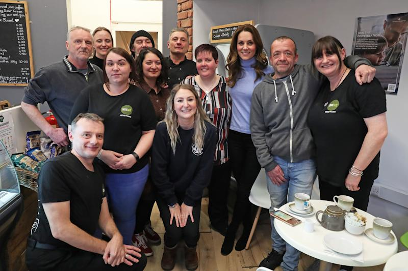 The Duchess of Cambridge, known as the Countess of Strathearn while in Scotland, has a poses for a photograph with members of staff during a visit to the Social Bite cafe in Aberdeen, to meet with locals for her Early Childhood survey. (Photo by Andrew Milligan/PA Images via Getty Images)