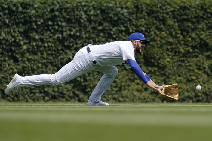 Chicago Cubs left fielder Kris Bryant can't make the play on a double by Arizona Diamondbacks' Eduardo Escobar during the first inning of a baseball game in Chicago, Saturday, July 24, 2021. (AP Photo/Nam Y. Huh)