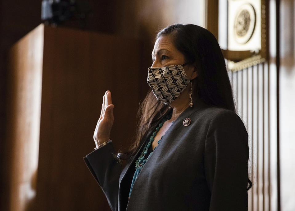 FILE - In this Feb. 23, 2021, file photo, Rep. Deb Haaland, D-N.M., is sworn in during a Senate Committee on Energy and Natural Resources hearing on her nomination to be Interior Secretary, on Capitol Hill in Washington. The Senate has confirmed New Mexico Rep. Deb Haaland as interior secretary, making her the first Native American to lead a Cabinet department and the first to lead the federal agency that has wielded influence over the nation's tribes for nearly two centuries. Democrats and tribal groups hailed Haaland's confirmation as historic. For the first time a Native American will lead the powerful department where decisions on relations with the nearly 600 federally recognized tribes are made. Interior also oversees a host of other issues, including energy development on public lands and waters, national parks and endangered species. (Graeme Jennings/Pool via AP, File)