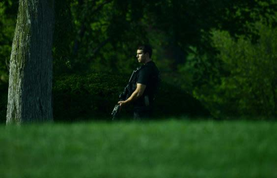 Members of the Secret Service took up positions after a shooting outside of the White House (Getty)