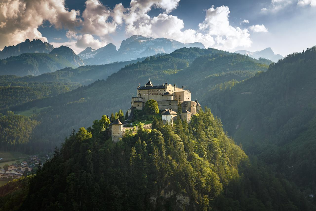 """Another medieval, mountaintop castle, Hohenwerfen Fortress is one of the most stunning sites in all of Austria—and <a href=""""https://www.cntraveler.com/gallery/photos-that-will-make-you-want-to-visit-austria?mbid=synd_yahoo_rss"""" target=""""_blank"""">that's saying something</a>. The 900-year-old castle overlooks the scenic Salzach River Valley (about 35 miles south of Salzburg), offering <a href=""""https://www.salzburg-burgen.at/en/hohenwerfen-castle/eventcalendar/romantic-advent-market-at-hohenwerfen-castle-359/"""" target=""""_blank"""">Christmas markets</a> and <a href=""""https://www.salzburg-burgen.at/en/hohenwerfen-castle/plan-visit/falconry/"""" target=""""_blank"""">falconry demonstrations</a> along with its daily tours."""