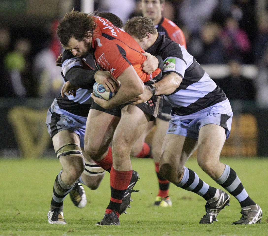 Newcastle Falcons' Mark Wilson (L) and Euan Murray (R) tackles Toulon's Carl Hayman (2R) during a pool 2, European Challenge Cup rugby union match at Kingston Park, Newcastle upon Tyne on December 8, 2011. AFP PHOTO/GRAHAM STUART (Photo credit should read GRAHAM STUART/AFP/Getty Images)