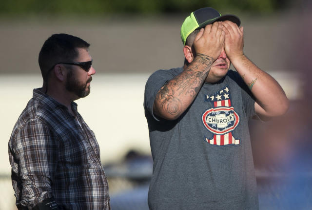 <p>A man wipes his eyes after a deadly shooting at the First Baptist Church in Sutherland Springs, Texas, Nov. 5, 2017. (Nick Wagner/Austin American-Statesman via AP) </p>