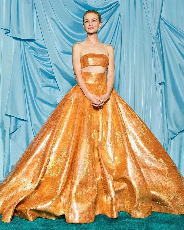 """<p>The star shined in a gorgeous <a href=""""https://people.com/style/carey-mulligan-oscars-2021-red-carpet/"""" rel=""""nofollow noopener"""" target=""""_blank"""" data-ylk=""""slk:gold sequin two-piece Valentino Haute Couture gown"""" class=""""link rapid-noclick-resp"""">gold sequin two-piece Valentino Haute Couture gown</a> as a nominee for Best Actress in a Leading Role for <em>Promising Young Woman</em>.</p>"""