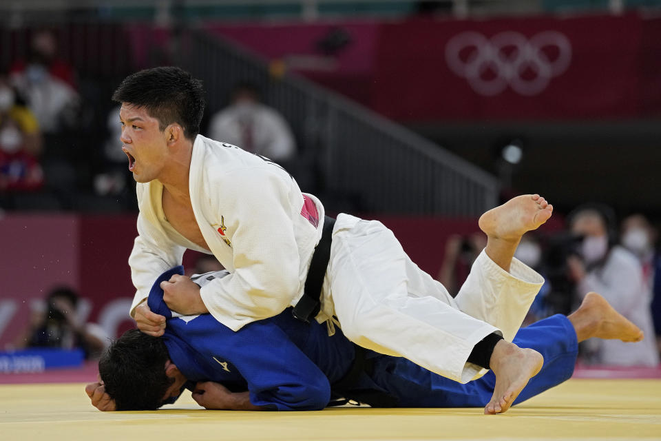 Shohei Ono of Japan reacts as he competes with Lasha Shavdatuashvili of Georgia during their men's -73kg judo final match, at the 2020 Summer Olympics in Tokyo, Japan, Monday, July 26, 2021. (AP Photo/Vincent Thian)
