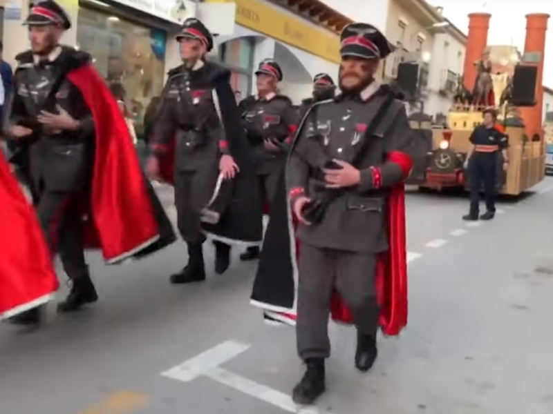 Men dressed as Nazi officers parade in front of a float in Campo de Criptana, Spain, on February 24, 2020: Europa Press
