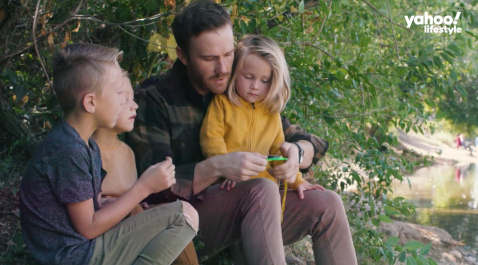 Jon Parrish and his three sons pause for a moment in wonder of the great outdoors. (Photo: Yahoo Lifestyle)