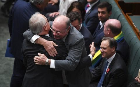Liberal MP Warren Entsch hugs Australian Prime Minister Malcolm Turnbull  - Credit:  REUTERS