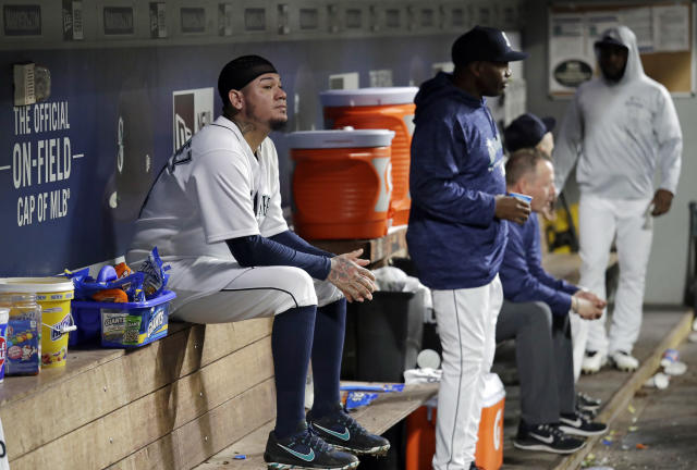 Seattle Mariners starting pitcher Felix Hernandez sits on the bench after being removed during the fifth inning of the team's baseball game against the Oakland Athletics on Wednesday, Sept. 26, 2018, in Seattle. (AP Photo/Elaine Thompson)