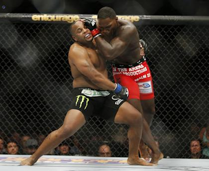 Daniel Cormier and Anthony Johnson duel during their UFC 187 bout. (AP)