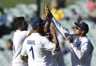 Indian players celebrate the wicket of Australia's Marnus Labuschagne on the third day of their cricket test match at the Adelaide Oval in Adelaide, Australia, Saturday, Dec. 19, 2020. (AP Photo/David Mariuz)
