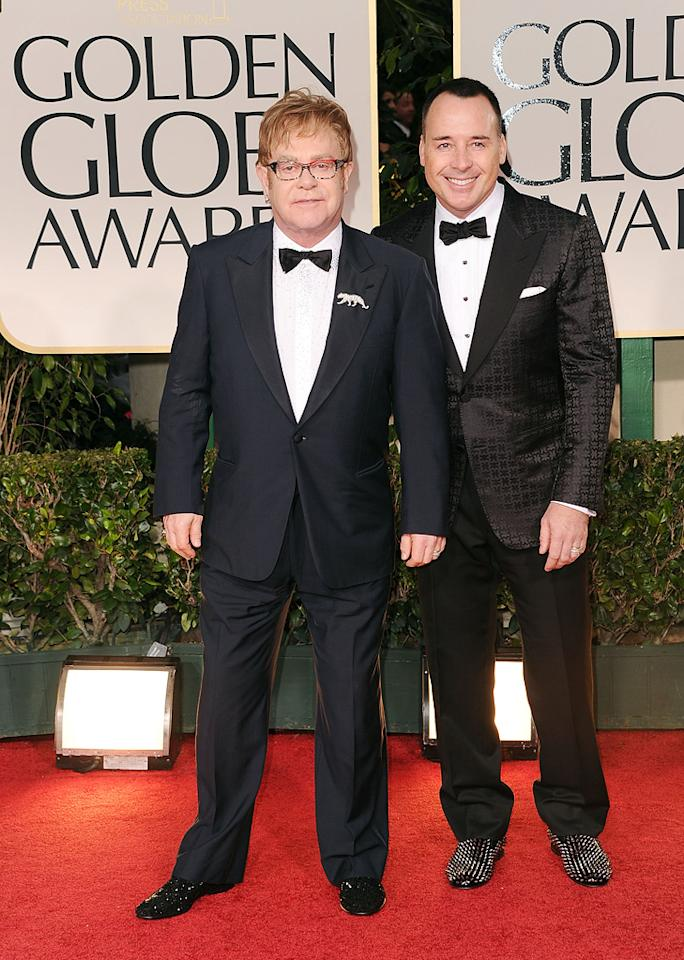 Elton John and husband David Furnish arrive at the 69th Annual Golden Globe Awards in Beverly Hills, California, on January 15.