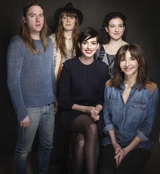 "In this Tuesday, Jan. 21, 2014 photo, from left, composers Johnny Rice and Jenny Lewis, actress Anne Hathaway, director Kate Barker-Froyland and actress Mary Steenburgen of the movie ""Song One"" pose for a portrait at The Collective and Gibson Lounge Powered by CEG, during the Sundance Film Festival, in Park City, Utah. The film had its premiere at the 2014 Sundance Film Festival. (Photo by Victoria Will/Invision/AP)"