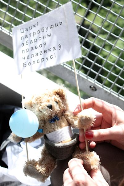 In this undated photo provided by Studio Total a teddy bear gets prepared with a flyer in Stockholm, Sweden. Thomas Mazetti and Hannah Frey from Sweden intruded with a light plane on the Belarus' airspace and dropped hundreds of teddy bears carrying slogans supporting human rights and media freedom, on July 4, 2012. The two Swedes behind the stunt, said their idea was to show support for Belarusian human rights activists and to embarrass the country's military, which is a pillar of President Lukashenko's power. (AP Photo/Studio Total/Per Cromwell)